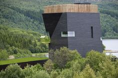 Built by Steven Holl Architects in Hamarøy, Norway with date 2009. Images by Ernst Furuhatt. This center dedicated to Hamsun is located above the Arctic Circle near village of Presteid of Hamarøy and the farm w...