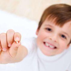 Por que você deveria guardar os dentes de leite do seu filho?