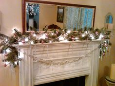 Vintage ornaments and glass bead strands, glass icicles, and star reflector lights on vintage ceiling tin and pine fireplace. Great DIY project.