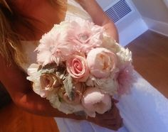 Pink peonies, feather flowers, and lots of roses make a very happy Muskoka bride, designed by www.opulencefloral.com Barrie GTA