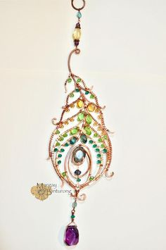 SALE Super sparkly Peacock feather gemstone suncatcher