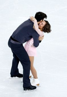 Meagan Duhamel and Eric Radford of Canada compete in the Figure Skating Pairs Short Program during the Sochi 2014 Winter Olympics