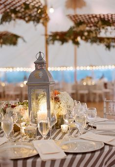 dinner receptions latern centerpiece | Late September Wedding at Nantucket's Westmoor Club : Brides