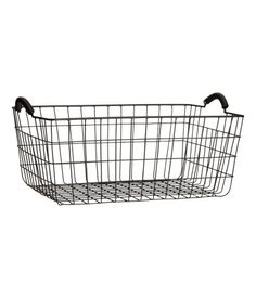 Black. Rectangular metal wire basket with two handles at top. Size 6 1/2 x 11 x 15 3/4 in.