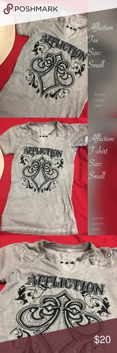 Affliction Embellished T-Shirt Get your affliction on with this distressed utterly cool tee. Embellished with silver studs, clear stones, and embroidery graphics it rocks. Throw on your jeans or shorts and you're perfect to go! Used item. Affliction Tops Tees - Short Sleeve