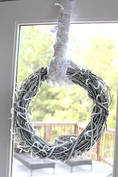 Trick-or-treat! Adorn your front door with this buggy mummy wreath.