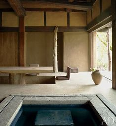 The traditional minka, with its shallow pool and sunken dining area, was transported from Japan and reconstructed on-site / Belgium / photo by Jean-Pierre Gabriel for AD