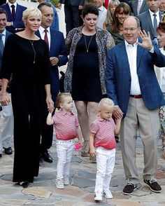 The royal couple Princess Charlene and Prince Albert II of Monaco were seen walking hand in hand with the adorable Prince Jacques (R)  and Princess Gabriella (L) at the Princess Antoinette park, as they take part in the traditional Monaco's picnic in Monaco.