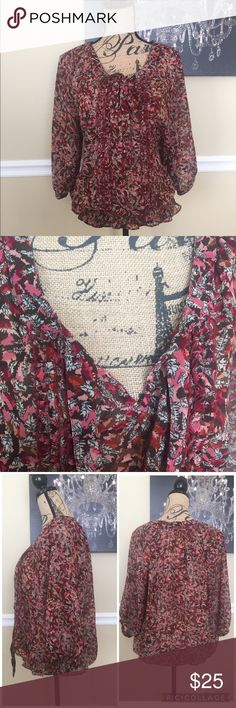 Gloria Vanderbilt Blouse This Gloria Vanderbilt sheer blouse is a size Large. It has 3/4 length sleeves with buttons, ties in front, has ruffles & light beading detail. Stretchy bottom shown in last picture. Condition is excellent. Gloria Vanderbilt Tops Blouses