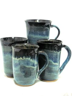 Wheel thrown stoneware coffee mugs glazed with Potters Choice Blue Rutile glaze and fired to cone 5 with a 30 minute hold in an electric kiln.