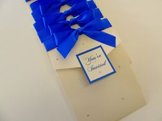 Oklahoma Wedding Invitations in Diamond and Royal Blue satin ribbon. £4.25 available to purchase online.