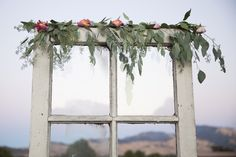 Back drop decorated with seeded eucalyptus, California pepper tree sprigs, peach, and pink roses We wanted the guest's attention to see what we get to see everyday the Mt Diablo hills.