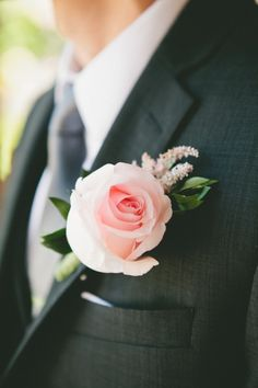 Pink rose boutonniere: http://www.stylemepretty.com/little-black-book-blog/2014/11/04/classic-romance-at-serra-plaza/ | Photography: Onelove - http://www.onelove-photo.com/