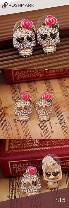 Sugar skull bling stud earrings Awesome sugar skull stud earrings with aurora borealis rhinestones and pink rose! Comfort guard backs. Jewelry Earrings