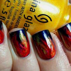 Hunger games nails using china glaze nail polish!