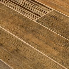 ceramic tile that looks like wood | Barrique Series Brun Wood Plank Porcelain Tile traditional floor tiles