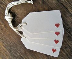 Gift tags - DIY - cut out red cross stitch perforated paper for the heart.  Repinned by www.mygrowingtraditions.com