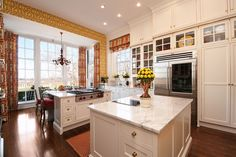 This white kitchen is found in the historic Malvern House in Louisville, KY. It's been updated to blend with the house, but provide modern sensibilities. Interior designer: Lee Robinson.