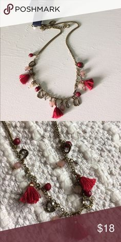 🆕Gap boho red bead tassel necklace Beautiful intricate necklace with a boho Spanish feel to it! Brass textured pieces hanging,deep red(burgundy) tassels,pink and red beads and tiny clear beads adorn this beautiful bass  tone chain. Mid length. GAP Jewelry Necklaces