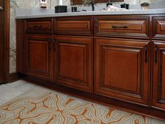 Refaced bathroom cabinets in maple with cafe' stain and chocolate glaze