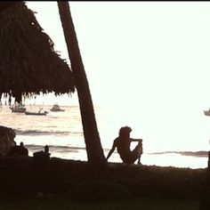 Tamarindo - Costa Rica / surfer on the beach at down / Pacific Ocean