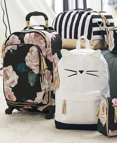 Don't you hate when you wait and wait for your luggage to come around the carousel but then you can't remember which bag is yours? Our new Emily and Meritt bags will take care of that with tons of personality, bold pattern and a touch of glam! Click to shop.: