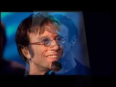 IN MEMORY of ROBIN GIBB pics w/Robin singing DON'T CRY ALONE.  Lovely.