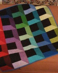 Gorgeous, colorful Attic Windows quilt pattern from the Pellon website