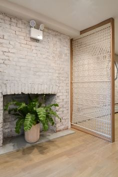 """While it has a notable zen vibe, it still feels right at home in New York. In the entrance, white-washed brick meets a handmade custom macramé screen by <a href=""""http://graceteng.com/"""" target=""""_blank"""">Grace Teng</a>, an artisan based in Brooklyn. Shelly and Grace had met at Anthropologie, and believe it or not, this was her first attempt at macramé."""