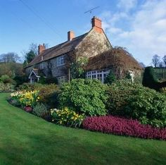 VIEW ACROSS THE MAIN LAWN TO THE COTTAGE AT CHIFFC...