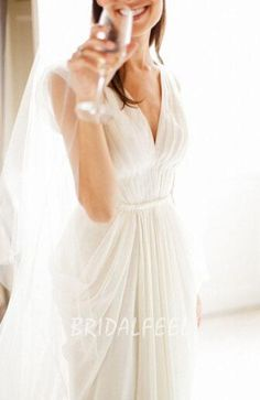 White A-line chiffon beach summer wedding dress, pleat deep v neck on the bodice. A line skirt features a little cap sleeves and flowing pleated hem.