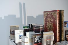 Mounir Fatmi, 'Save Manhattan 01' , 2004, table, books published after Sept. 11th, 2001, strings and spotlight, around 150 x 90 cm. Image courtesy the artist and Goodman Gallery, Johannesburg - Cape Town. Photograph by Jean-Paul Senn.