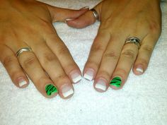 Gel nails white tips and bright green accent nail!