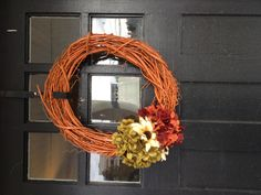 Grapevine wreaths I made for my front doors.