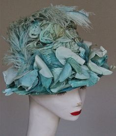 """Early 1900s Vintage Hat with Silk Velvet Flowers and Dyed Ostrich Feathers- 22"""". $55.00, via Etsy."""