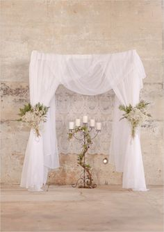 I could do this for the venue. It would be easy to add a little color, and adding the babys breath with the ferns would be pretty cheap
