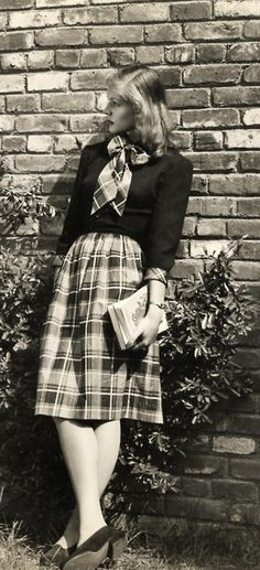 Lauren Bacall in a plaid skirt with matching bowtie, 1943.                                                                                                                                                                                 More