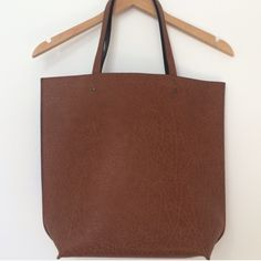 "A&F Reversible Tote Fully reversible from a brown tote to a black tote. Perfect for every outfit. Faux leather. 15.75"" W x 14.5"" H. Straps are 9"". Two pockets inside. Abercrombie & Fitch Bags Totes"