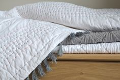 The Juno is a contemporary chain stitch quilt in soft white cotton, with a decorative tassel edging and chain stitch pattern in coral, grey and navy. Red Bedding, Linen Bedding, Bed Linens, Ikea, Hotel Bedroom Design, Bed Company, Summer Bedroom, Pottery Barn Teen Bedding, Natural Bedding