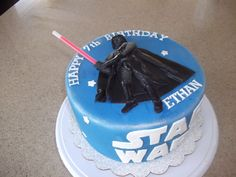 Star Wars birthday cake (Darth Vader) The Force is Strong in this one...figure carved and layered out of gumpaste, light saber is a glowstick