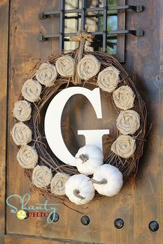 This has inspired me...the kids and I can gather acorns from all over the yard as well as nuts from the grandparents yards and glue them all over a grapevine wreath!