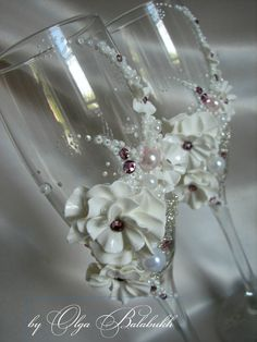 Two elegant hand decorated wedding champagne glasses by  A LIITLE TOO ORNATE WOULD TONE IT DOWN BUT I LIKE
