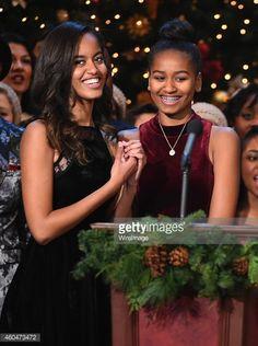 Malia Obama and Sasha Obama speak onstage at TNT Christmas in Washington 2014 at the National Building Museum on December 14, 2014 in Washington, DC. 25248_001_0582.JPG