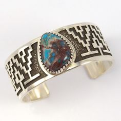 "Sterling Silver Cuff Bracelet set with a Natural Bisbee Turquoise Cabochon from Arizona and Overlaid Navajo Rug Designs. 1"" Cuff Width 5.75"" Inside Measurement, plus 1"" opening (6.75"" Total Circumfere"