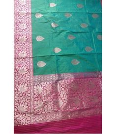 Green Pink Border Pure Handloom Banarasi Silk Katan Saree-----Struggling to decide what to pack as part of your wedding trousseau? You know you can never be wrong when choosing a couple of Banarasi sarees. These timeless creations are perfect for this special phase of your life and you know they will never go out of style even several years down the line.--------Sarees from luxurionworld.com