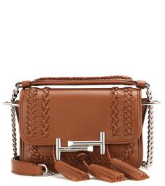 Tod's - Double T Mini leather shoulder bag - Tod's shows off a bohemian twist on the label's covetable Double T Mini design this season. The compact size is perfect for toting all of your daytime essentials, while the warm tan leather, woven detailing and playful tassels add effortlessly chic edge. Carry yours over your shoulder or in the crook of your arm for a refined look. seen @ www.mytheresa.com