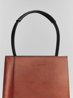 Our new Alfie One Tapered Tote is a simple, minimalistic structured bag. It's…