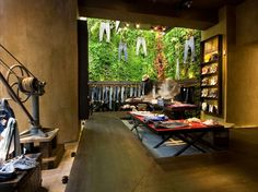 Great textures in this green store design in Florence. Love the natural, rugged quality.