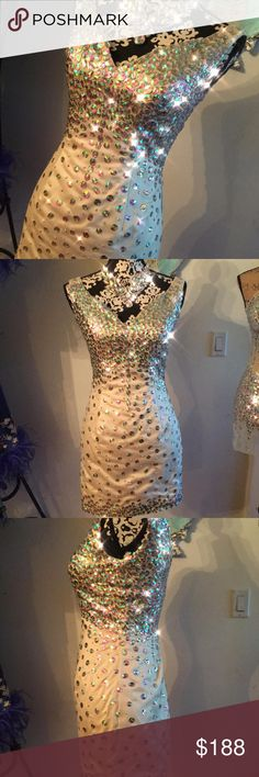 "AB Crystal Rhinestone Bodycon Prom Mini Dress Fabulous AB crystal rhinestone dress. Unfortunately this dress is too big for me, my loss = your gain ;)  fully lined  Size small/ medium  Please see photos for measurements.  The mannequin wearing the corset in the photos measures about 34"" at bust, 28"" at waist and 36"" at hip. Empire Couture Dresses Mini"