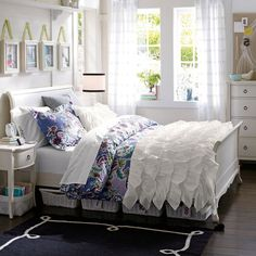 Love this comforter, it would be so nice in my daughter's room....but only in another color.  Don't trust her with white! :)